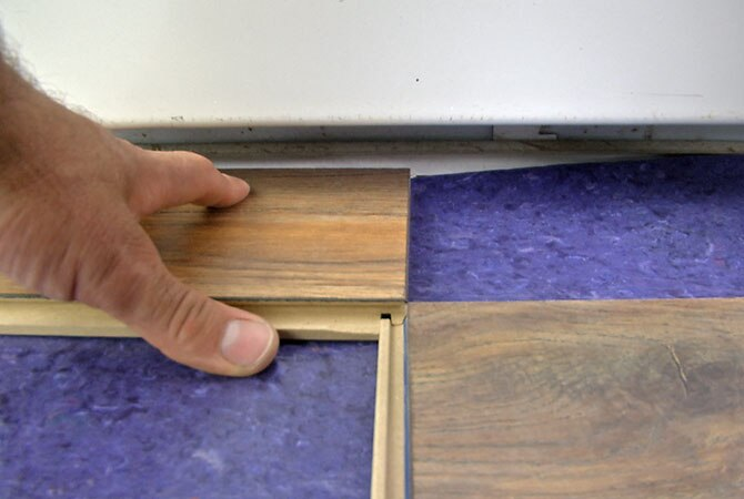 Laminate Floors Lock Together On All Sides Each With It S Own Proprietary System Here The End Piece Slips In As You Fit And Pieces